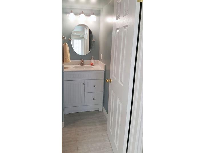 White Bathroom Vanity in basement bathroom
