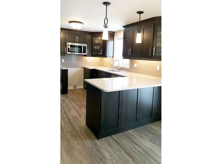 Maple kitchen with quartz countertops