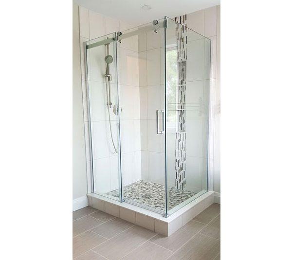 Corner shower with pebble stone base