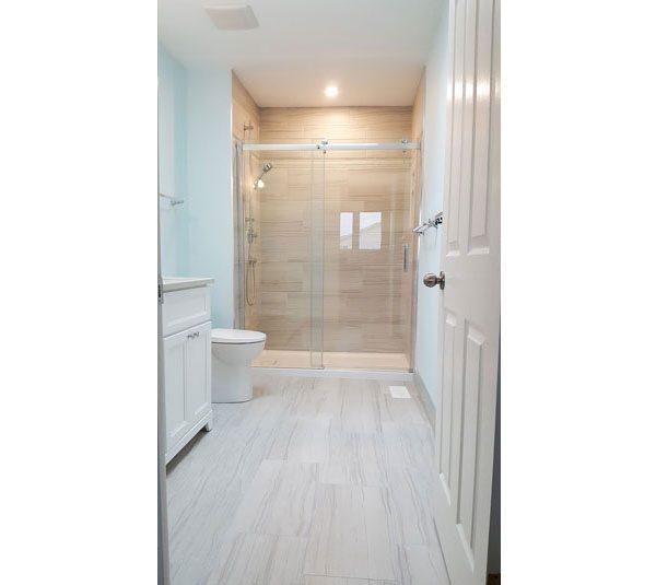 Glazed porcelain tile floor and shower surround
