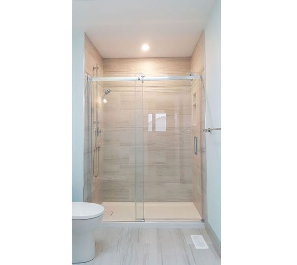 Alcove shower with glazed porcelain tile surround