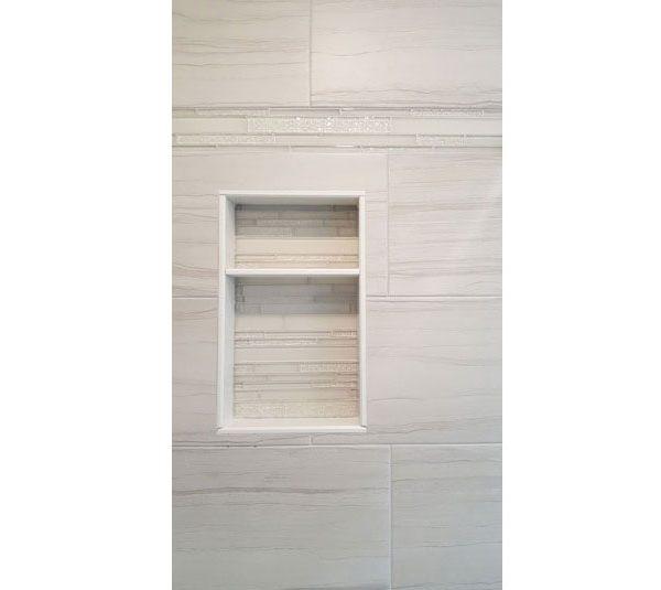 Glass mosaic tile inside shower niche