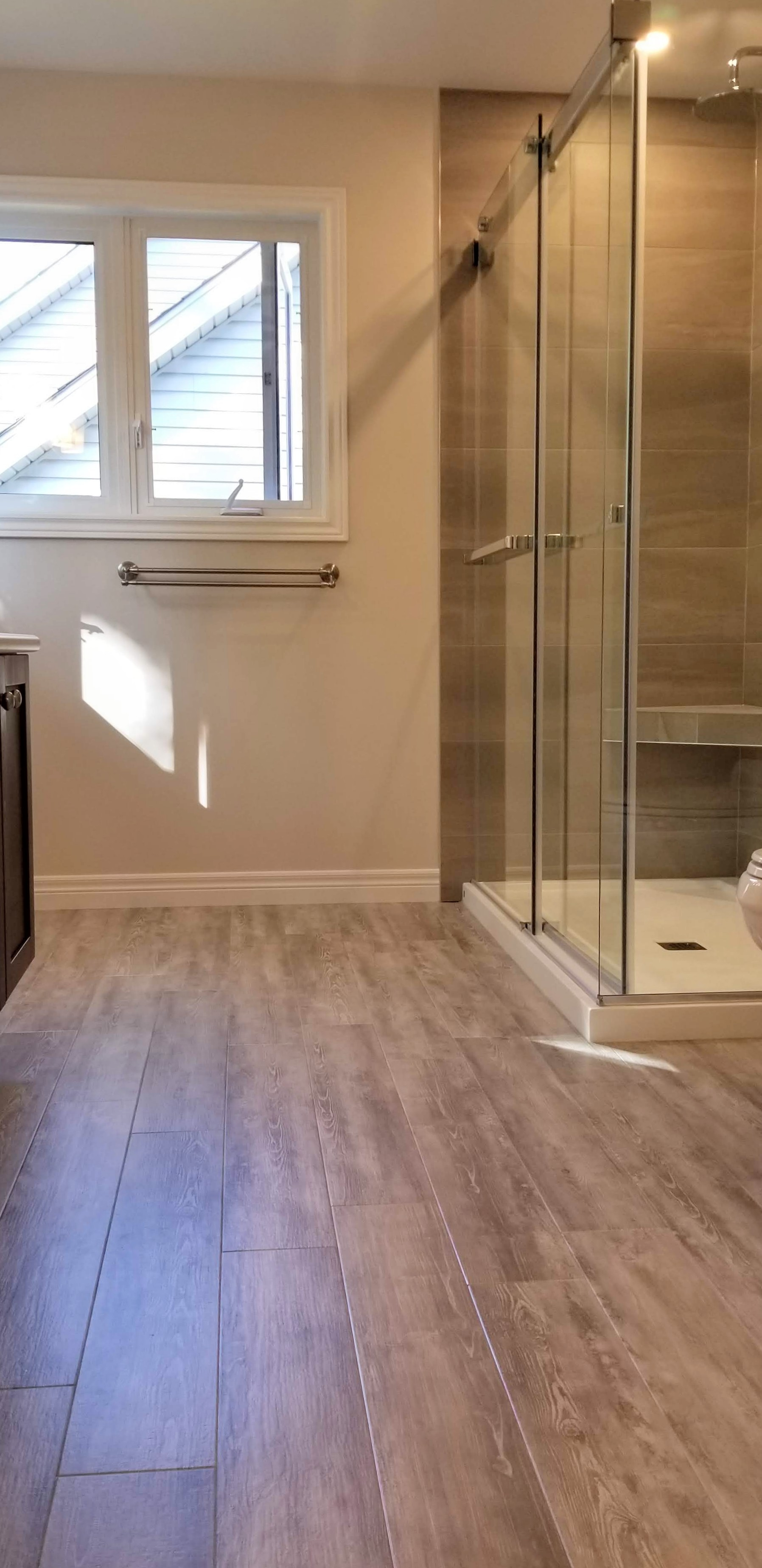 Ensuite bathroom floor was replaced with vinyl plank flooring by Germano Creative Interior Contracting Ltd.