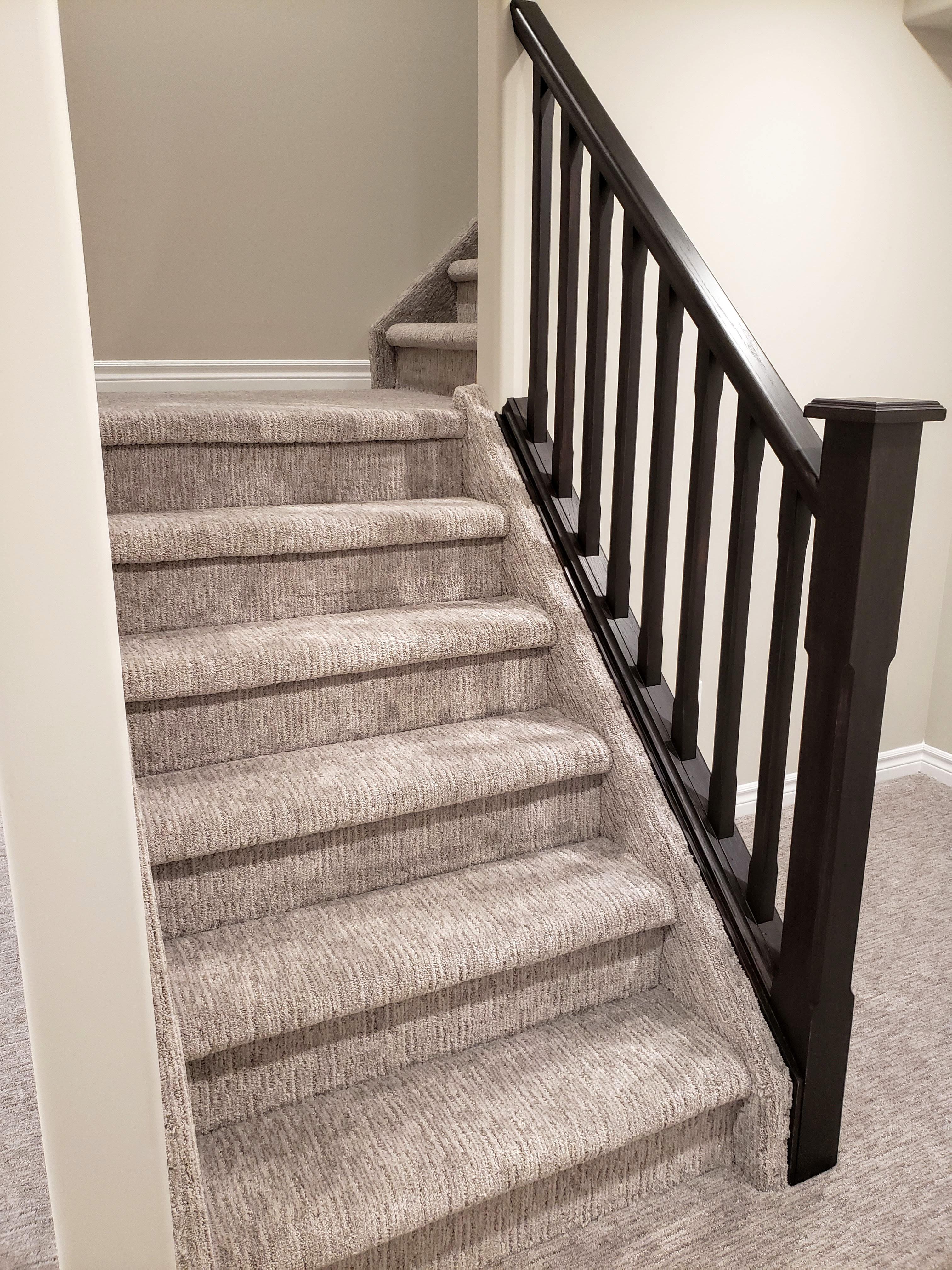 Oak railing in basement by Germano Creative Interior Contracting Ltd.