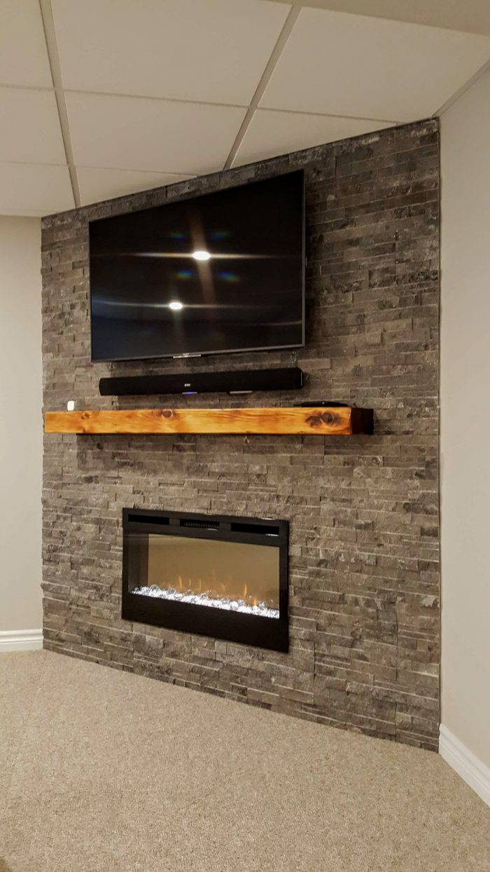 Electric fireplace with ledge stone surround