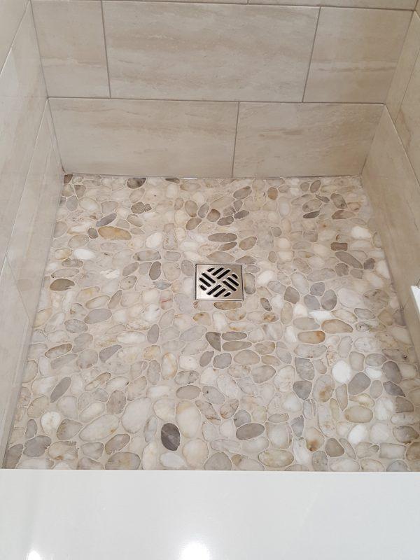 Pebble stone shower base