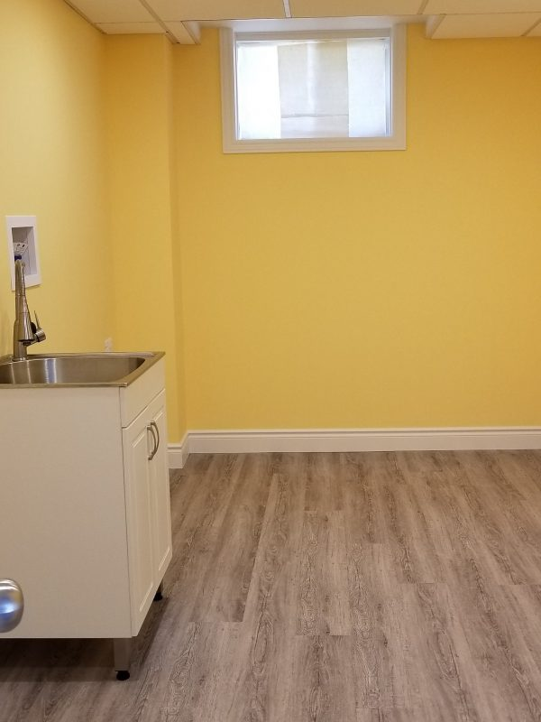 Vinyl plank flooring in laundry room