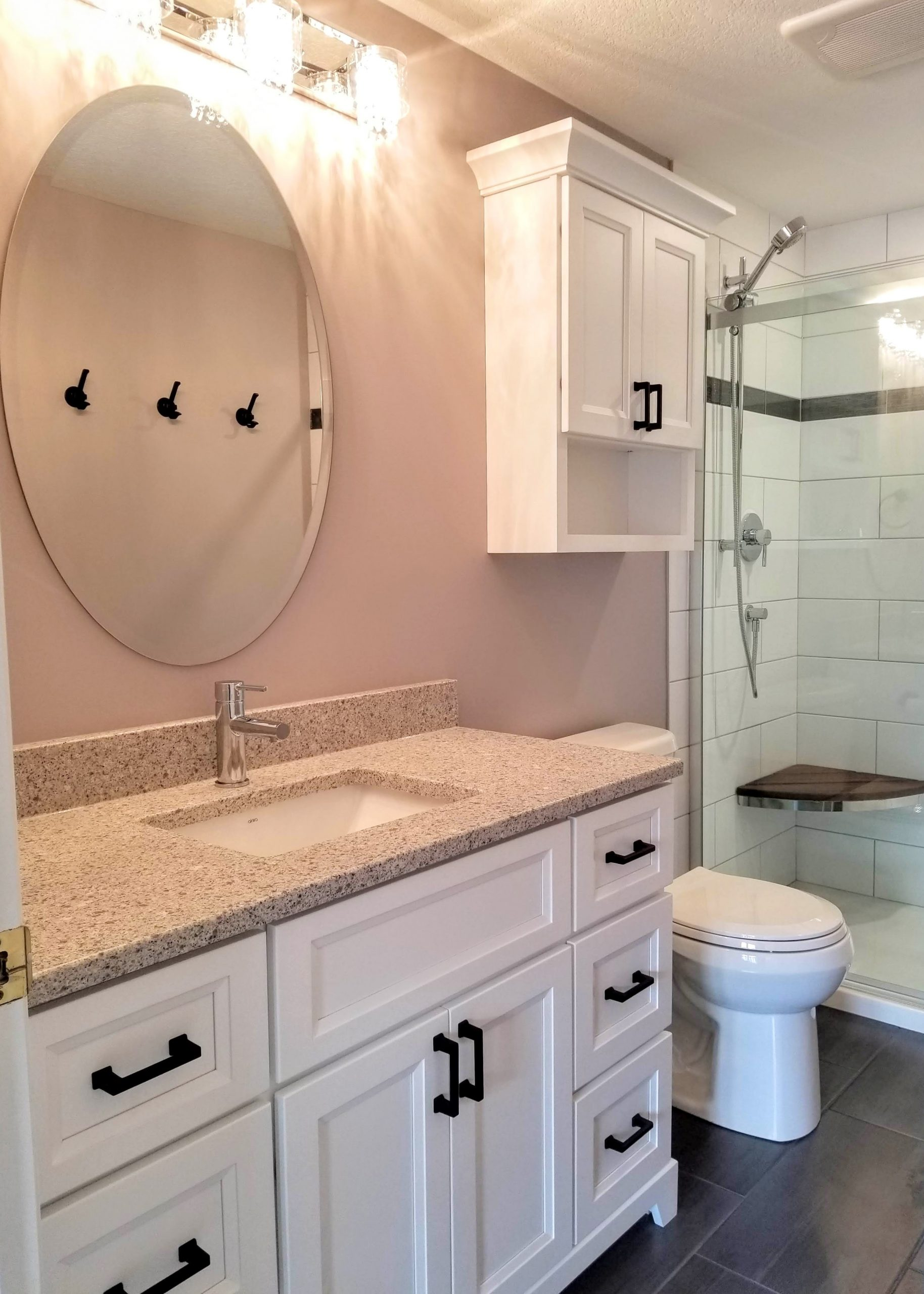 White vanity with quartz countertop