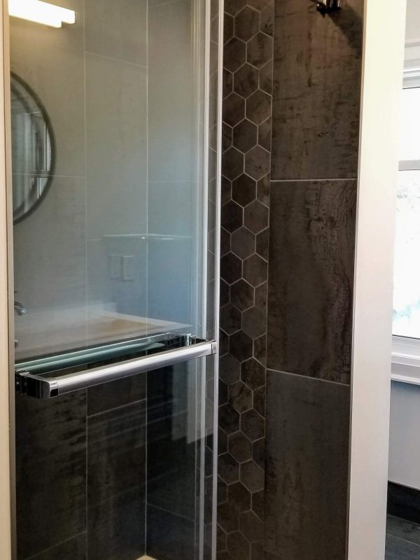 Sliding glass door shower system