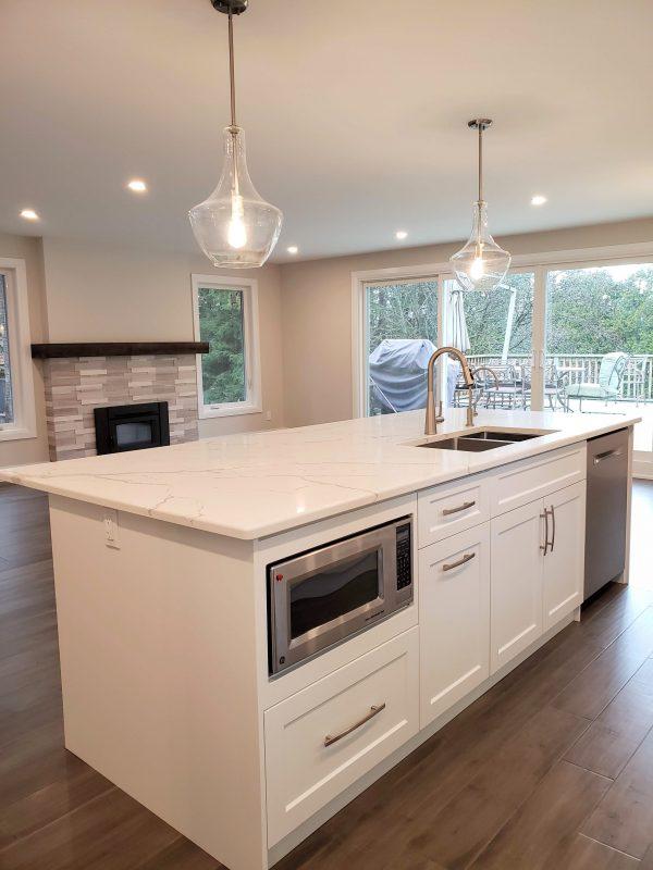 Kitchen island featuring quartz countertops