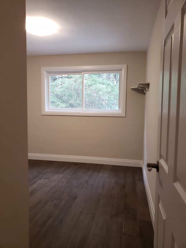 Engineered hardwood flooring and new window installed