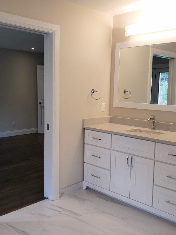 White vanity with matching vanity mirror