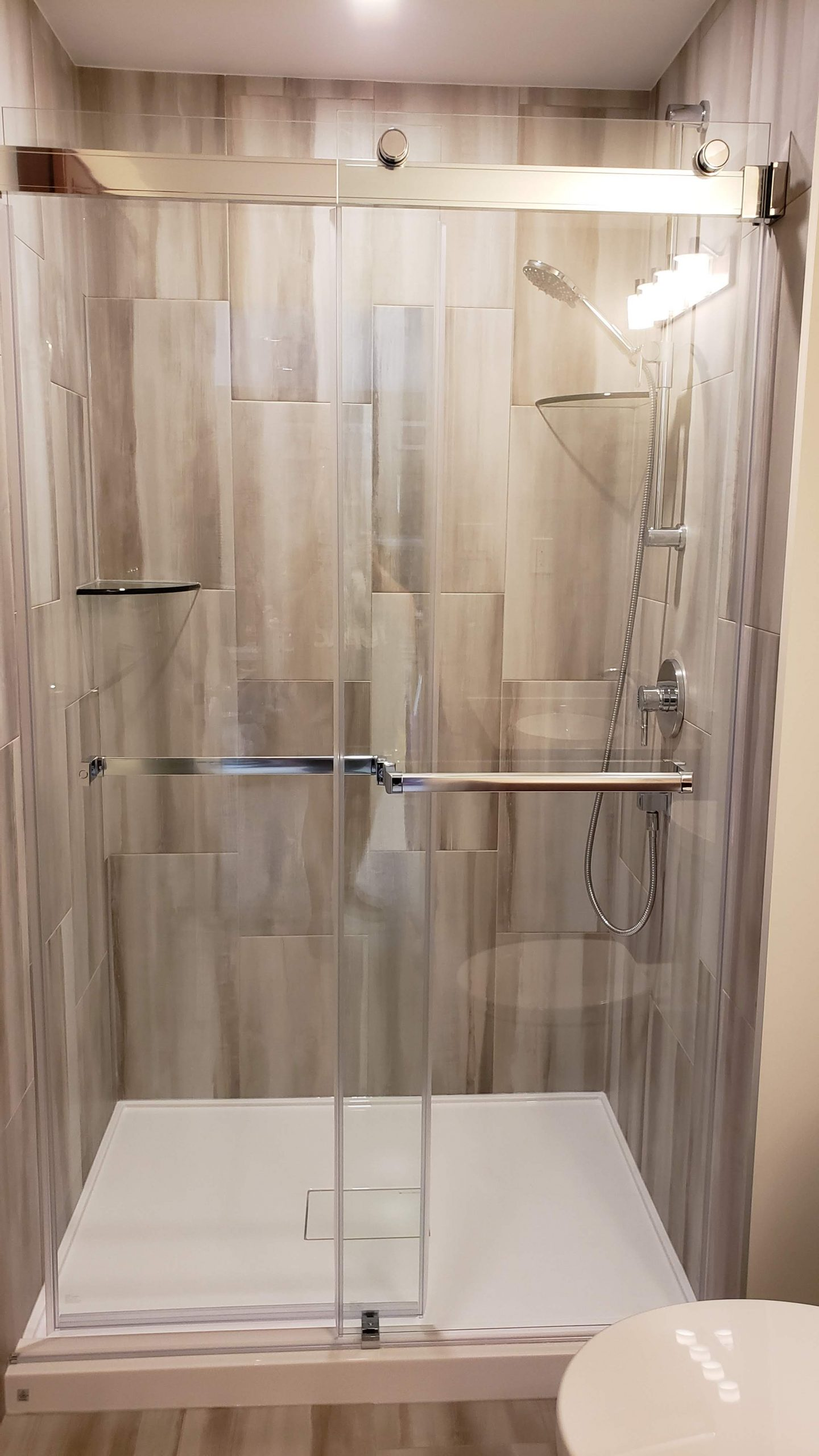 Glass bypass shower system with acrylic base