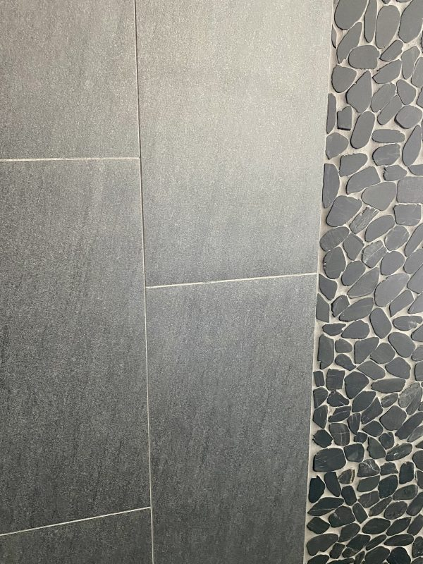Notion carbon porcelain tile with Zen pebble accent