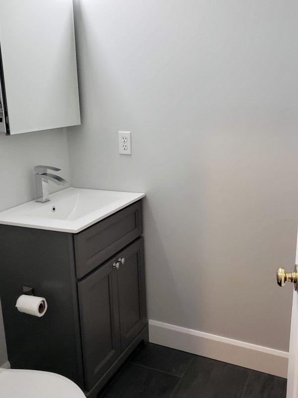 Powder room featuring single sink graphite paint vanity