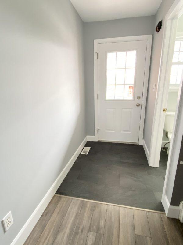 Entryway featuring black 12x24 porcelain tile